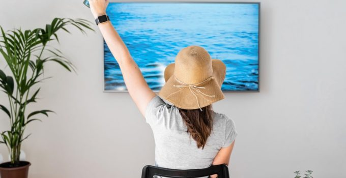 Woman at home pretending to be on the beach in Mexico