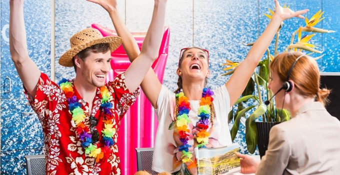Man and woman booking vacation to Mexico in travel agency